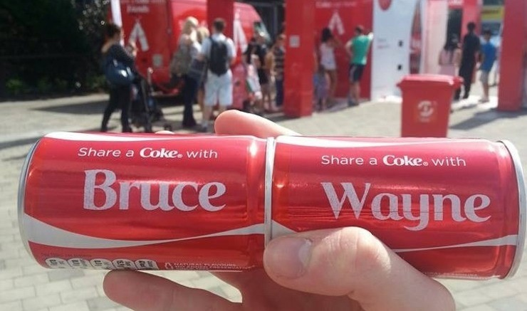 cans of coke with names on it